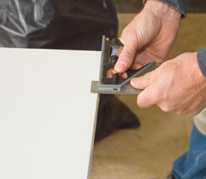 Adjust your combination square to the amount you want to remove from the door bottom.