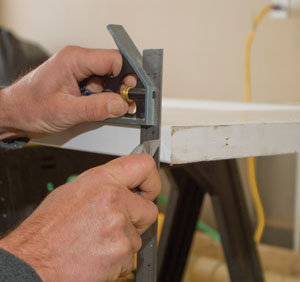 Extend the scoring marks down the door edges. This prevents tear-out during cutting.