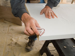 Use a sanding block to shape a slight chamfer all the way around the bottom of the door.