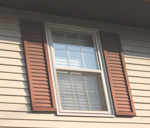 The paint of the old louvered aluminum shutters had faded dramatically, so they were replaced with the new urethane shutters with a raised double-pane design.