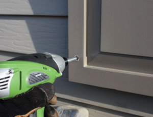Make sure the screw heads lie below the surface of the shutter, leaving room for the wood filler to follow.