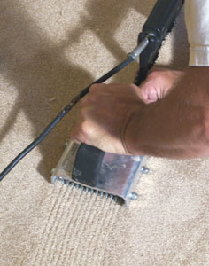 Press the carpet firmly into the seaming tape with a carpet seam roller.