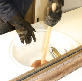 When plunging, use a wet rag to seal off the overflow drain to create a vacuum.
