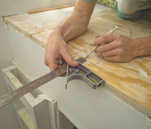 Determine the location of the newel post, trace the outside of the newel and mark where the rim joist should be.