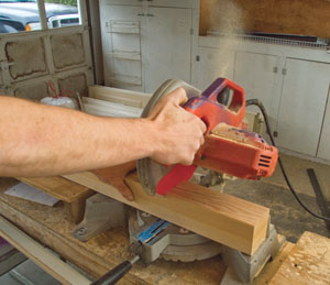 A miter saw is used to cut the newel post to length.