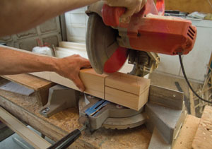 A 10-inch miter saw was used to carefully extend the horizontal shoulder cuts down to the vertical tenon cuts.