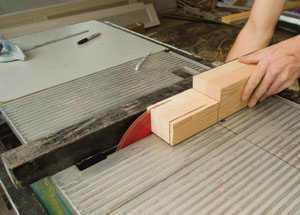 Repeat the process of using the table saw to remove extra material around the tenon; being careful each time to stop the cut at the mark on the table saw surface.