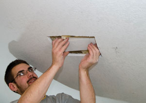 To install backing in drywall, we always cut a big enough access hole to maneuver the size of the backer board needed into position.