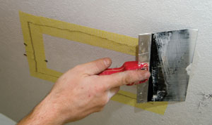 It's a good idea to begin your drywall patch before fastening the guardrail to the ceiling. This is an easier process with the rail out of the way.