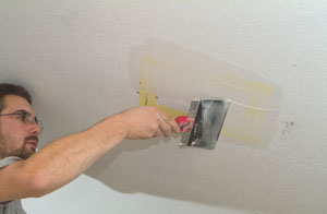 The drywall patch for the backing access hole should include seam tape and drywall joint compound.