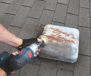 Sand away rust on metal roof fixtures and coat with an oil based metal primer.