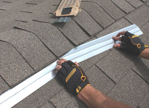 Zinc strips installed over asphalt shingles can protect the roof from algae stains.