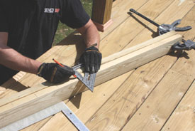 """Clamp the top and bottom rails together, and mark them 4-1/2"""" on center."""