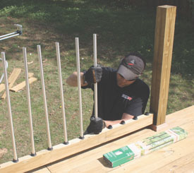 Slide the aluminum balusters onto the rubber baluster connectors.