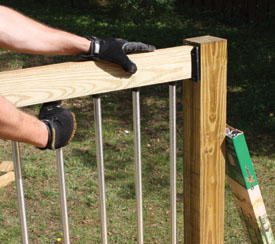 Carefully seat the connectors of the upper rail onto the ends of the aluminum balusters, and fasten the rail securely.