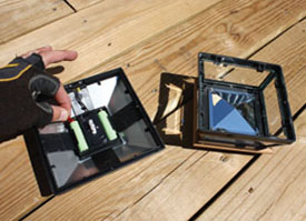 Activate the Solar Post Lights by removing the plastic tab from the battery terminal.