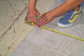 Cut the vinyl about one inch extra all the way around. Pay attention to the best locations for full pattern squares as you should with tile floors.