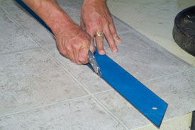 Use a straight edge and a sharp knife to make the initial rough cuts.