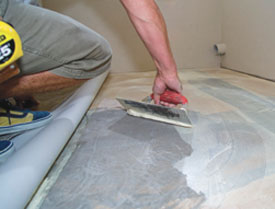 You can stand on the flat part of the folded back area but don't get on the fold. A crease will damage the flooring.
