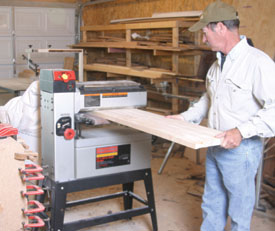 A drum sander is used to sand and smooth the glued-up countertop.