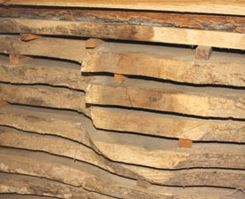 The sawn wood planks must be stacked apart with wooden stickers for air circulation.