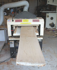 Before using for construction, the dried lumber must be shop-milled. A power planer, such as the Woodmaster shown, is used for surface and thickness planing.