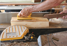 A jointer is used for surface planing small pieces and edges of larger pieces. A hand-held plane or power planer is used to surface-finish large planks that won't run through a planer.
