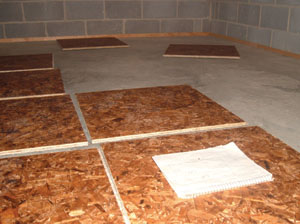 Lay out the floor to determine what cuts you'll have to make at the perimeter walls.