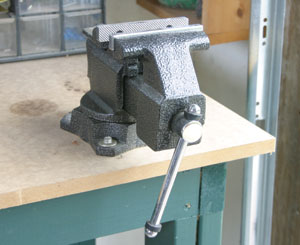 Vises for both metal and woodworking are extremely important. They should be located on sturdy benches or work surfaces.