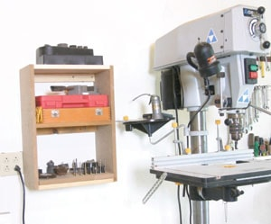 A drill press can be used with a wide variety of accessories. A shelf or cabinet close at hand holds the accessories needed.