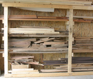 Lumber must be stored flat and well supported. A 2 x 4 rack is one answer.