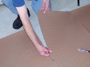 Trim the covering with a utility knife or scissors.