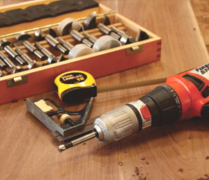 Using a forstner bit, bore holes for the wood plugs.