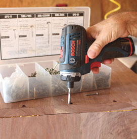 """Place glue on the pieces and clamp together. Then drill with a 1/8"""" bit for the screws, fasten the chest case together."""