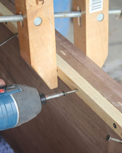 Fasten the aprons in place with glue and wood screws.