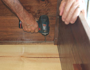 Cut the bottom and fasten it in place with hardwood cleats.