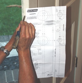 Schlage includes a paper template to help locate the holes for the door hardware.