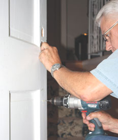 A through-bolt anchors the bottom of the handle to the door.