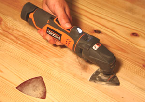 The Ridgid JobMax oscillating tool features a removal head for an interchangeable body that connects to different tool heads.