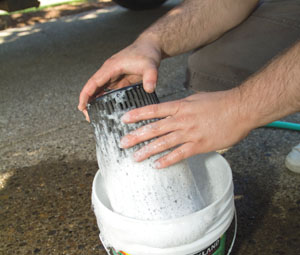 Thoroughly wash the filter with soap and water. Dish soap works well to cut the oil in the filter treatment products.