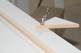 After measuring and cutting the face board to length, find center and clamp a triangle shaped scrap of wood with one point at the center line and the high point of the desired arc.