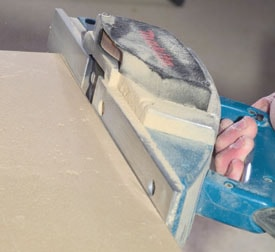 Use a power planer to shape along the scribe marks.