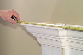 Measure and cut the mantel shelf, allowing for the reveal of the crown molding.