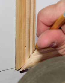 The miters at the arced horizontal piece will need a little extra attention. You can overlap the horizontal piece over the vertical and trace the angle. The new angle can be cut with a sharp utility knife.