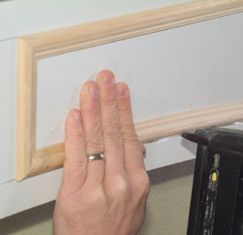 Apply carpenter's glue to the back of the bottom horizontal piece and bend it into place following the layout lines. When you like it, nail it.