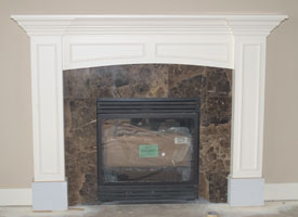 "Mantel completed with surround in place. After the stone surround is in place, mill a 1/4""-thick piece and bend it into place on the underside of the arc."