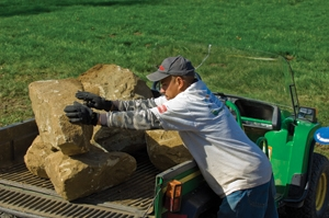 Moving large rocks around can be a challenge and often requires the use of wheelbarrows, utility vehicles and tractors.