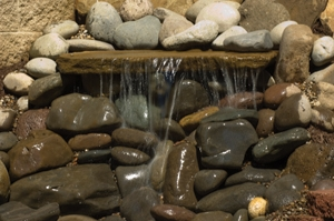 The flagstone used for this waterfall shelf was quarried from the ground a stone's throw from where it now lives.