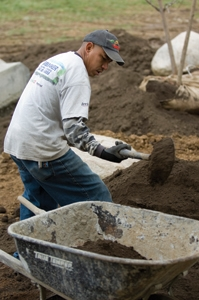 After positioning the rocks, Ashland's guys spread loam to prepare the landscape for a variety of plants.