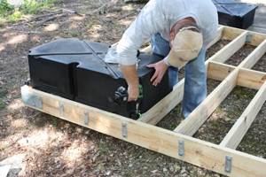 """The floats install with 1/2"""" stainless steel lag screws driven into the underside of the joists."""